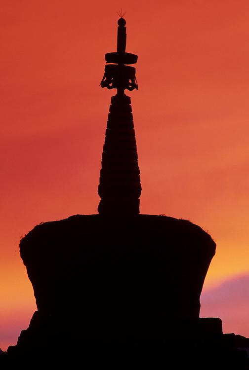 Asia, Nepal, Khumbu Region. Dramatic sunset behind stupa (Buddhist shrine) at Tengboche Monastery.