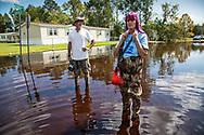 Jane and Chris Ochsenbein walking around in Bucksport, South Carolina following Hurricane Florence.