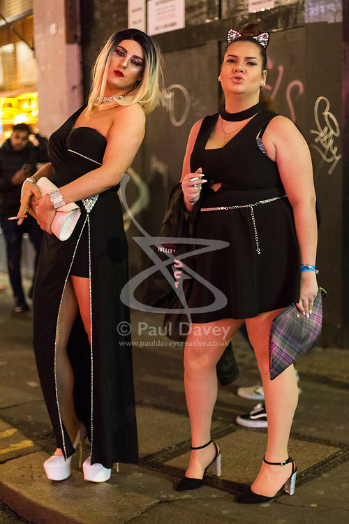 London, January 01 2018. A drag queen and her friend pose for a picture on Old Compton Street, Soho, as revellers in London's West End enjoy New Year's Eve. © SWNS