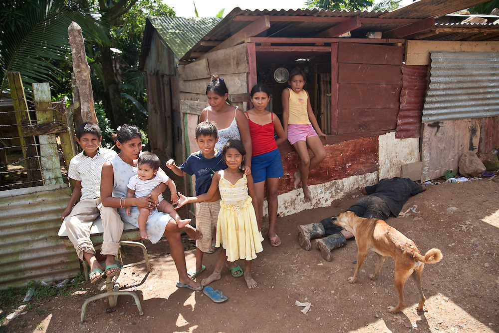 man of the house:  carolina inherited the house from her mother but still had to pay rent demanded by her own brother. she lives with her sister and the nine children they have between them, but can barely afford to pay electricity bills. any money that comes in is squandered by her brother, the man of the house, to the right of the photo.