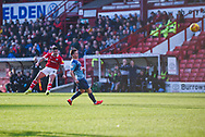 Alex Mowatt of Barnsley (27) hits a shot from long range during the EFL Sky Bet League 1 match between Barnsley and Wycombe Wanderers at Oakwell, Barnsley, England on 16 February 2019.