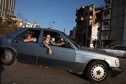 © Licensed to London News Pictures. 16/08/2020. Beirut, Lebanon. A family look at the blast site in Beirut Port following the huge explosion on 4 August. Photo credit : Tom Nicholson/LNP