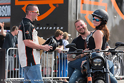 Road Rash and Bacon of Pensacola, FL joke around with Harley-Davidson's Anthony Slomczewski after getting back from a Softail test ride during Daytona Bike Week 75th Anniversary event. FL, USA. Saturday March 5, 2016.  Photography ©2016 Michael Lichter.