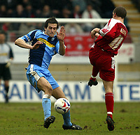 Photo: Chris Ratcliffe.<br />Leyton Orient v Wycombe Wanderers. Coca Cola League 2. 25/03/2006.<br />Mike Williamson of Wycombe goes in hard on Joe Keith of Leyton Orient