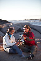 Male and female drinking tea or coffee. Wearing sports gear while camping. Out door food drink item set. Travel tool, camping explorer equipment. Nature picnic rest. Thermos with hot beverage.