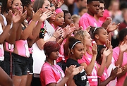 Lindenwood University - Belleville students applaud a Lindenwood play in the first half of their Homecoming Game against the Menlo College Oaks.  They are wearing pink shirts due to October being Breast Cancer Awareness Month.