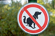 """A """"no dog pooping"""" sign in the town square of Bargteheide, Germany, stands right next to the 13th Century Lutheran Church in the town square. (Supporting image from the project Hungry Planet: What the World Eats.)"""
