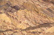 Marbled patterns in sedimentary rock at Zabriskie Point, Death Valley National Park, California