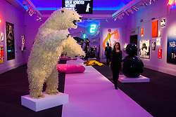 """London, March 4th 2015. Sotheby's in London hosts """"one of the most extraordinary collections of our time"""", an anonymous collector's vast assembly of fine art pieces, including skulls, bear sculptures, paintings and installations. PICTURED: Sotheby's main gallery presents a surreal picture dominated by Paola Pivi's lifesize feathered polar bear sculpture, Life Is Great."""