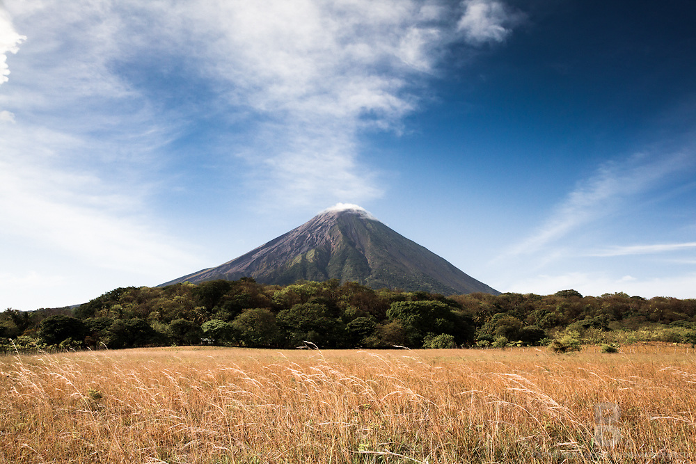 Volcano Concepción in an idyllic grass field landscape on Ometep Island in Nicaragua.
