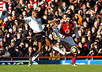 Photo: Javier Garcia/Back Page Images<br />Arsenal v Fulham, FA Barclays Premiership, Highbury, 26/12/04<br />Collins John, left and Robert Pires stretch for the ball