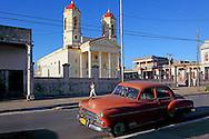 Car and church in Pinar del Rio, Cuba.
