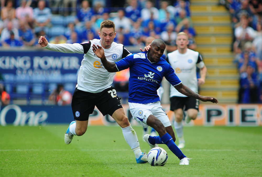 Leicester City's Lloyd Dyer vies for possession with Peterborough United's Lee Frecklington ..Football - npower Football League Championship - Leicester City v Peterborough United - Saturday 18th August 2012 - King Power Stadium - Leicester..