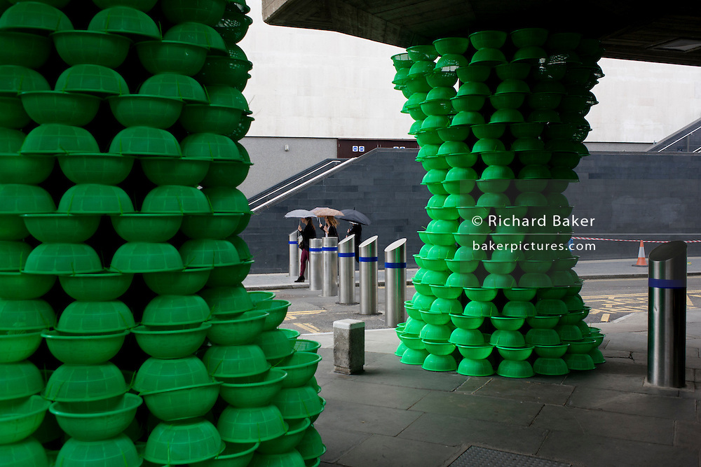 Southbank's Festival of the World staircase landscape with Korean artist Choi Jeong Hwa's hundreds of bright green plastic colanders around the grey columns, instantly transforming them into exotic plants.