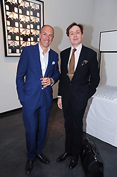 Left to right, DYLAN JONES and NICK FOULKES at a private view of photographs by David Bailey entitled 'Then' held at Hamiltons, 13 Carlos Place, London W1 on 6th July 2010.