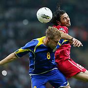 Turkey's Selcuk INAN (R) and Kazakhstan's Heinrich SCHMIDTGAL (L) during their UEFA EURO 2012 Qualifying round Group A soccer match Turkey betwen Kazakhstan at TT Arena Istanbul September 02, 2011. Photo by TURKPIX