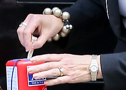 © Licensed to London News Pictures. 25/010/2018. London, UK. Prime Minister Theresa May places money in a charity box as she meets fundraisers for the Royal British Legion and purchase a poppy to launch the National Poppy Appeal 2018 outside 10 Downing Street. Photo credit: Dinendra Haria/LNP