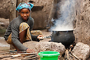 A girl cooks in the village of Kabe, Mali on Monday August 30, 2010..