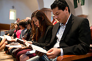 Juan Enriquez sits with his family during mass at St Ann Catholic Parish in Coppell, Texas on October 12, 2014. (Cooper Neill for The New York Times)