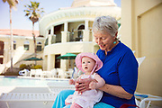 Grandmother with Granddaughter at pool