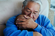Ed Naranjo, chief of the Goshute Indians, is embracing his grandson, Izaiah Naranjo, 9 month, inside his home in the Goshute Reservation of Deep Creek Valley, on the Nevada-Utah border, USA.