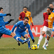 Istanbul BBSpor's Efe INANC (C) and Galatasaray's Juan Pablo PINO (R) during their Turkish soccer superleague match Istanbul BBSpor between Galatasaray at the Ataturk Olympic stadium in Istanbul Turkey on Saturday 26 February 2011. Photo by TURKPIX