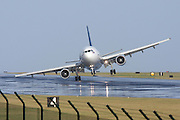 Inches from disaster: Terrifying moment a plane carrying 200 passengers is almost smashed into runway by storm winds<br /> <br /> This is the terrifying moment a gust of wind tilts a passenger plane's wings towards a runway - and inches away from disaster.<br /> More than 140 people were on board the A310 as it hit the tarmac while its pilots battled against stormy weather in Lajes in the Azores.<br /> Plane spotter Paulo Santos has travelled the world photographing every type of aircraft. But he said nothing could have prepared him as he snapped the astonishing moment the A310 battled against the wind.<br /> Mr Santos said: 'When I heard that he was cleared to land and after hearing the air traffic controllers announce severe turbulence and almost 45 knots of cross winds, I got my camera from the car, and climbed the wall. <br /> 'I saw the airplane do some crazy manoeuvres until it got close to the ground, and it was then that they caught some huge wind shear, getting the airplane in the position you see in the picture.<br /> 'The pilots struggled to keep the aircraft in one piece, and they finally managed to do it safely. 'The aircraft landed and slowed down until they entered the taxiway. I just felt that something was on their side. It could have been so much worse.' None of the passengers and crew on board the SATA International internal flight from Lisbon was injured. Photo Shows: Near disaster: A gust of wind tilts this A310's wing towards the runway as it comes into land in Lajes in the Azores<br /> (©Paulo santos/Exclusivepix)