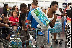 September 5, 2017 - Fort Lauderdale, Florida, U.S - Residents of south Florida stock up with water at Walmart in Fort Lauderdale in preperation for hurricane Irma. A state of emergency was declared for all counties in Florida on Monday, in anticipation of possible impact of category five Hurricane Irma later this week. (Credit Image: © Orit Ben-Ezzer via ZUMA Wire)
