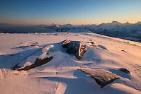 Winter dawn over mountain landscape from summit of Ryten, Moskenesøy, Lofoten Islands, Norway