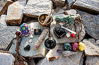 Dragon magic outdoors altar. Crystal ball, smudge, singing bowl, and other ritual tools. Dragon head in the background with mala falling out of focus and blurred color crystal stones.<br /> <br /> FOCUS on each item and feel it's energy come through. It is coming through this picture as the magick is still working. Power to you.