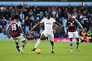 Eder of Swansea city goes past Kieran Richardson of Aston Villa (l). Barclays Premier league match, Aston Villa v Swansea city at Villa Park in Birmingham, the Midlands on Saturday 24th October 2015.<br /> pic by  Andrew Orchard, Andrew Orchard sports photography.