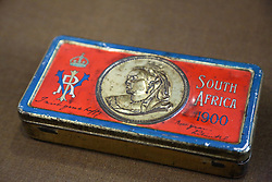© Licensed to London News Pictures. 19/12/2013. Tin of chocolate sent to troops overseas in 1900 for new New Year by Queen Victoria is on show for the first time at Firepower Museum. Christmas boxes for solders from the present day back to 1900 have gone on show at the Firepower Musuem in South East London. The collection includes a New Years christmas tin sent in 1900 by Queen Victoria. Some historians think she should be credited with the annual gift box rather than Princess Mary who was responsible for the Christmas box, sent in 1914. It's the first time the Victorian box has gone on show at the museum, which is one of the oldest military museums in the world. Please contact Richard Smith-Gore at Firepower for quotes and additional info. Credit : Rob Powell/LNP