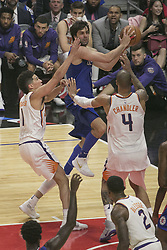 October 21, 2017 - Los Angeles, California, U.S - Milos Teodosic #4 of the Los Angeles Clippers and Devin Booker #1 and Tyson Chandler #4 of the Phoenix Suns during their regular season game on Saturday October 21, 2017 at the Staples Center in Los Angeles, California. Clippers defeat Suns, 130-88. (Credit Image: © Prensa Internacional via ZUMA Wire)