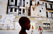 25 JULY 2002 - HAVANA, HAVANA, CUBA: A boy in front of his dilipidated apartment building in Havana, Cuba, July 25, 2002..PHOTO BY JACK KURTZ