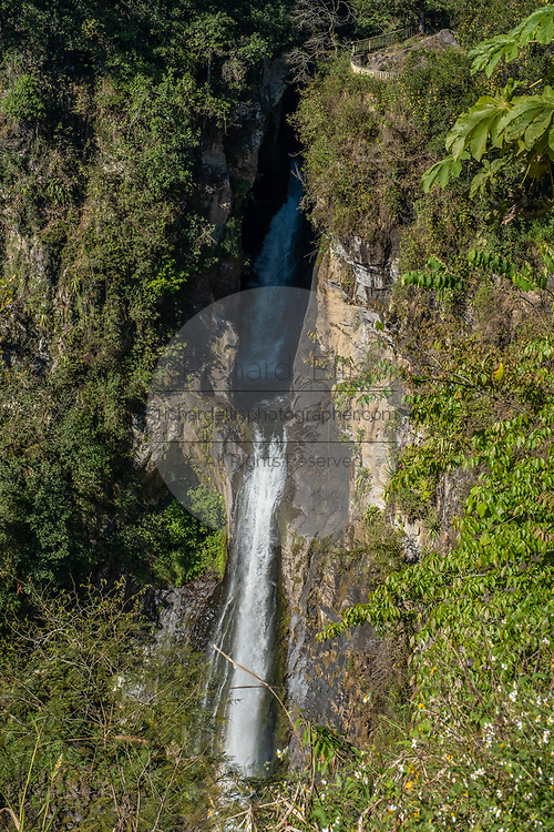 The Cascada de Texolo waterfall cutting through the jungle in Xico, Veracruz, Mexico. The 80-foot high waterfall was used in the movie Romancing the Stone.