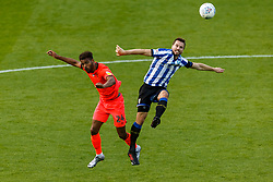 Steve Mounie of Huddersfield Town and Julian Borner of Sheffield Wednesday - Mandatory by-line: Daniel Chesterton/JMP - 24/06/2020 - FOOTBALL - Hillsborough - Sheffield, England - Sheffield Wednesday v Huddersfield Town - Sky Bet Championship