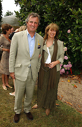 """VISCOUNT & VISCOUNTESS ASTOR at the Goodwood Festival of Speed on 9th July 2006.  Cartier sponsored the """"Style Et Luxe' for vintage cars on the final day of this annual event at Goodwood House, West Sussex and hosted a lunch.<br /><br />NON EXCLUSIVE - WORLD RIGHTS"""