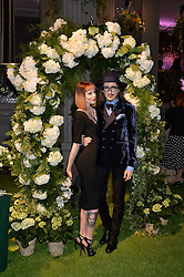 JOSHUA KANE and FRANCESCA MERRICKS at an English Garden party to celebrate the re-launch of the Grosvenor House Hotel, Park Lane, London on 21st June 2016.