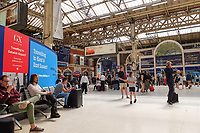 GV_Waterloo Mainline Railway Station, London, UK, Sunday, 24th June 2018, 201806244452<br /><br />Copyright Image from Victor Patterson, 54 Dorchester Park, <br />Belfast, UK, BT9 6RJ<br /><br />t1: +44 28 9066 1296 (from Rep of Ireland 048 9066 1296)<br />t2: +44 28 9002 2446 (from Rep of Ireland 048 9002 2446)<br />m: +44 7802 353836<br /><br />victorpatterson@me.com<br />victorpattersonbelfast@gmail.com<br /><br />Please see my Terms and Conditions of Use at victorpatterson.com. It is IMPORTANT that you familiarise yourself with them.<br /><br />Images used on the Internet incur an additional cost and must be visibly watermarked i.e. ©Victor Patterson within the body of the image and copyright metadata must not be deleted. Images used on the Internet have a size restriction of 4kbs and are chargeable at rates available at victorpatterson.com.<br /><br />This image is available only for the use of the download recipient i.e. television station, newspaper, magazine, book publisher, etc, and must not be passed on to any third party. It is also downloaded on condition that each and every usage is notified within 7 days to victorpatterson@me.com<br /><br />The right of Victor Patterson (or the named photographer) to be identified as the author is asserted in accordance with The Copyright Designs And Patents Act (1988). All moral rights are asserted.