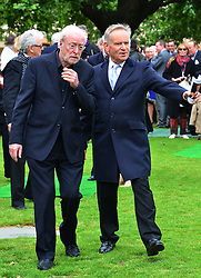 Michael Winner public memorial.  <br /> Sir Michael Caine and Jeffrey Archer during the Memorial.<br /> Memorial takes place at the National Police Memorial. The film director and food critic helped establish, following his death on January 23 2013. <br /> Geraldine Winner, Sir Michael Parkinson, Sir Michael Caine, Sir Roger Moore, Cilla Black, Carol Vorderman, Sir Terence Conran, give eulogies, <br /> London, United Kingdom<br /> Sunday, 23rd June 2013<br /> Picture by Nils Jorgensen / i-Images