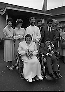 Historic Wedding Bells For Disabled Couple,  (N81)..1981..20.06.1981..06.20.1981..20th June 1981..Happy wedding bells chimed today for the first disabled couple in residential care to marry in the Republic of Ireland. The happy couple are Marie Skully and Pat Linehan and they were married in a special ceremony in The Cara Cheshire Home in the Phoenix Park. Both Marie and Pat are confined to wheelchairs because of their disabilities. After honeymoon, they will make their home in specially adapted quarters within the Cheshire residence...The happy couple pose for pictures with the priest,bridesmaids and groomsmen..If you know the names of the priest and family members why not let us know and we will add them to the caption.