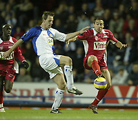 Photo: Aidan Ellis.<br /> Blackburn Rovers v AS Nancy. UEFA Cup. 13/12/2006.<br /> Rovers Andre Ooijer (L) and Nancy's Pascal Berenguer
