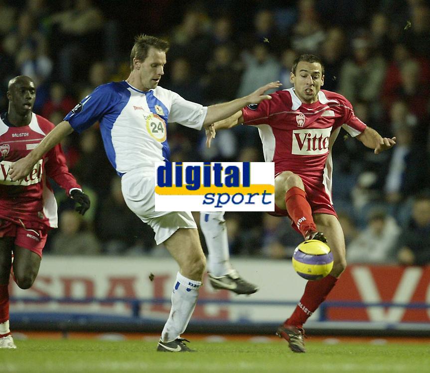 Photo: Aidan Ellis.<br /> Blackburn Rovers v AS Nancy. UEFA Cup. 13/12/2006.<br /> Rovers Andre Ooijer (L) and Nancy's Pascal Berenguer