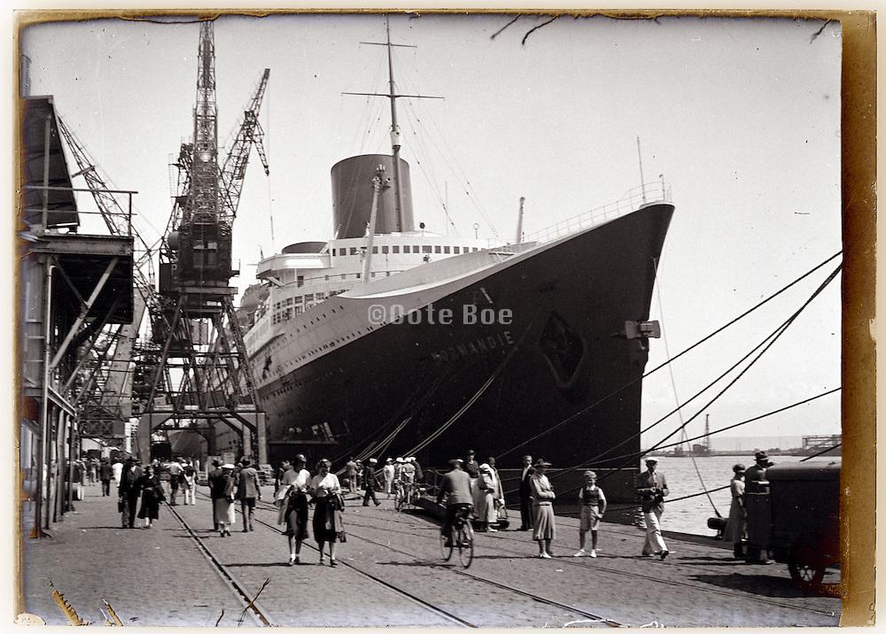 the luxury passenger ocean liner SS Normandie moored in harbor 1930s