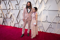 Jason Mamoa and Lisa Bonet arrive on the red carpet of The 91st Oscars® at the Dolby® Theatre in Hollywood, CA on Sunday, February 24, 2019.