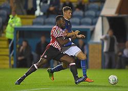 Carlisle United's Richard Bennett battles with Sunderland's Lamine Kone (left)