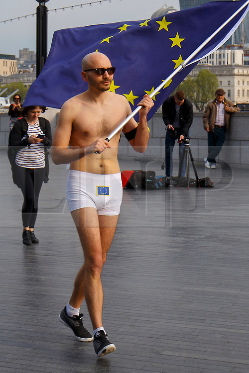 © Licensed to London News Pictures. 09/05/2016. London, UK. A semi-naked man waves the European Union flag near City Hall in London on the day that British Prime Minster David Cameron and former Mayor of London Boris Johnson both deliver speeches on Britain's membership of the EU and the upcoming EU referendum. Photo credit: Tolga Akmen/LNP