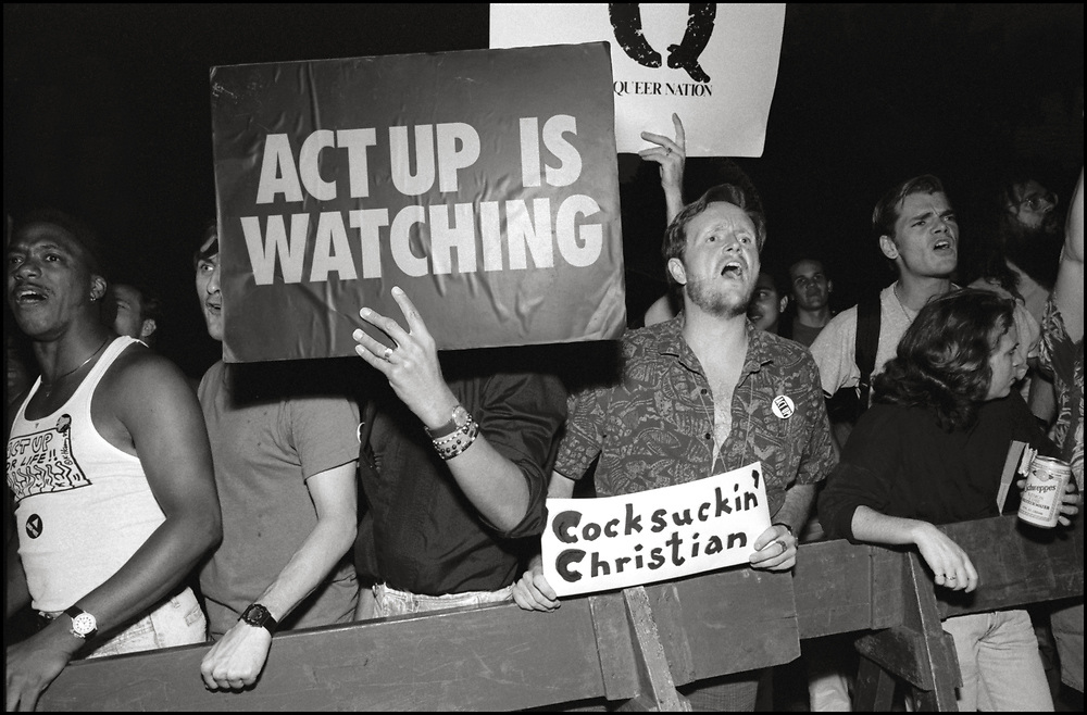 """In August of 1990, approximately 150 gay men and lesbians confronted the devotees of Our Lady of the Roses, a group that claims a membership of 42,000 Catholics who believe that a Long Island woman named Veronica Lueken is a """"voice box"""" for divine revelations. The action, dubbed """"The Rosary Action"""" was organized by Queer Nation to highlight the hypocrisy of fundamental christians. The Lady of The Roses protests New York's Gay Pride Parade in front of St. Patricks Cathedral every year.<br /> <br /> Queer Nation is an LGBTQ activist organization founded in March 1990 in New York City, by HIV/AIDS activists from ACT UP. The four founders were outraged at the escalation of anti-gay violence on the streets and prejudice in the arts and media. <br /> <br /> Veronica Lueken was a Roman Catholic housewife from Bayside, New York, who, between 1970 until her death in 1995, reported experiencing apparitions of the Virgin Mary, Jesus, and numerous Catholic saints. She gave messages she claimed to have received from them at both the grounds of Saint Robert Bellarmine Catholic Church in Bayside, and at the exedra monument at the 1964 New York World's Fair Vatican Pavilion site in Flushing Meadows Park. Pilgrims from around the world would gather to pray for the world's salvation, witness miraculous healings and receive messages from the Virgin Mary and Jesus Christ."""