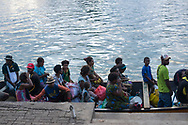 Shortly before sunset, passengers fill a boat bound for the short ride to their homes in Krangket Island in Madang, Papua New Guinea. (August 2017)