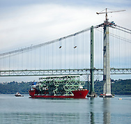 Third Tacoma Narrows Bridge construction work bringing deck sections into place, while traffic passes on the nearby second Tacoma Narrows Bridge (the new bridge will carry eastbound traffic on Washington State Route 16 from the Kitsap Peninsula across the Tacoma Narrows, a part of Puget Sound, Tacoma, Washington, USA (July 2006) (The first bridge at this location was nicknamed Galloping Gertie and was destroyed by wind due to a flaw in its design in 1940 soon after construction was complete. The second bridge, nicknamed Sturdy Gertie was opened in 1950.) The third Tacoma Narrows bridge was opened for traffic in July of 2007.